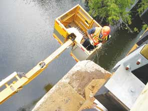 Applying Surtreat to a bridge