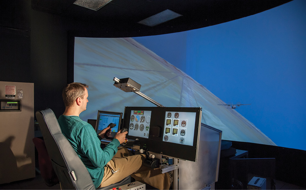 A pilot using a flight simulator