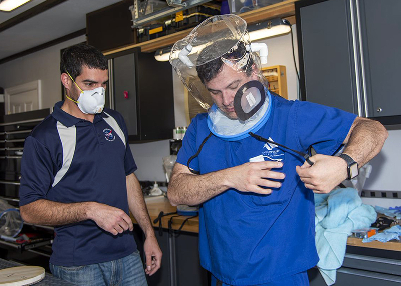 Armstrong Flight Research Center engineer Mike Buttigieg, left, and Dr. Daniel Khodabakhsh trying on the hood.