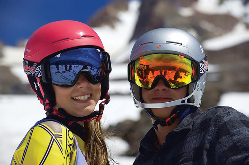 Skiers wearing protective lenses