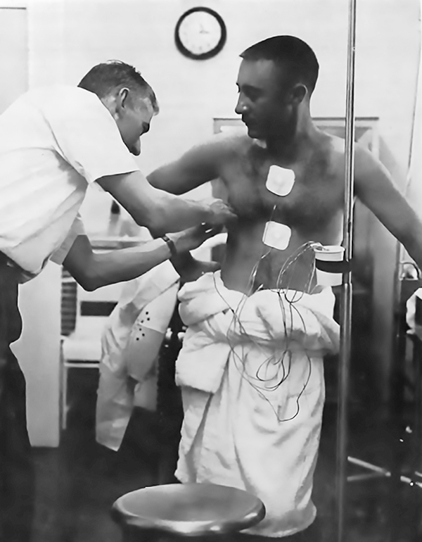 Astronaut Gus Grissom is fitted with health sensors