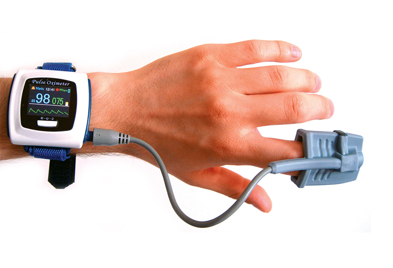 blood oxygen monitor on hand