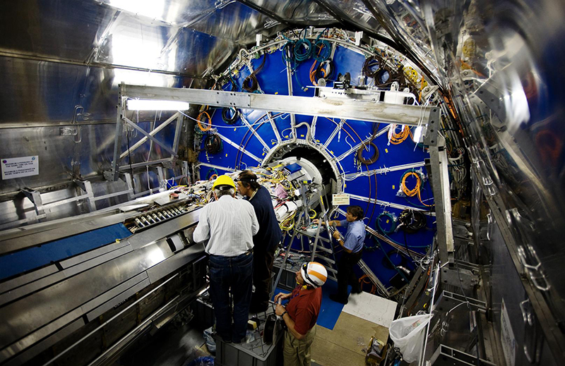 Scientists examine the Large Hadron Collider