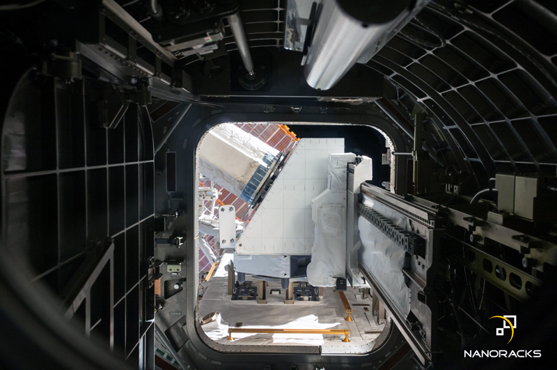 view of the NanoRacks External Payload Platform from inside the International Space Station