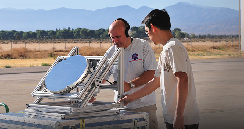 Haris Riris and Stewart Wu tinker with a Methane Sounder prototype