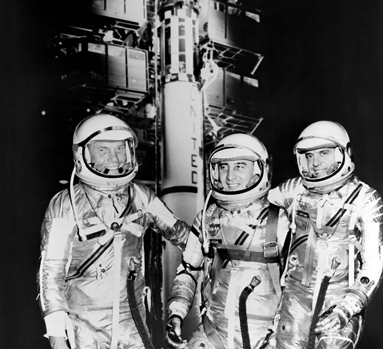 Astronauts John Glenn, Gus Grissom, and Alan Shepard in their spacesuits