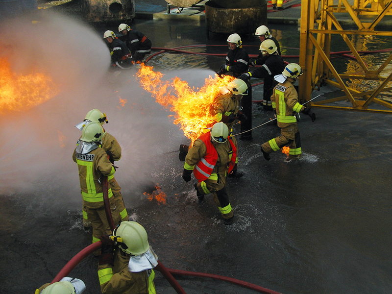Firefighters wearing protective PBI suits during a training fire