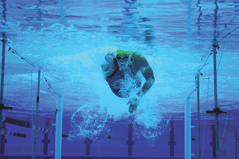 An athlete swims toward the camera