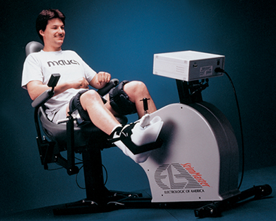 A man exercises on a device that stimulates muscles suffering from paralysis