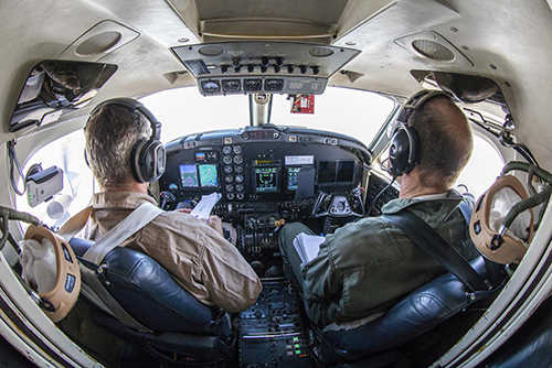 NASA pilots Peter Coen and Wayne Ringelberg in the B200 King Air cockpit