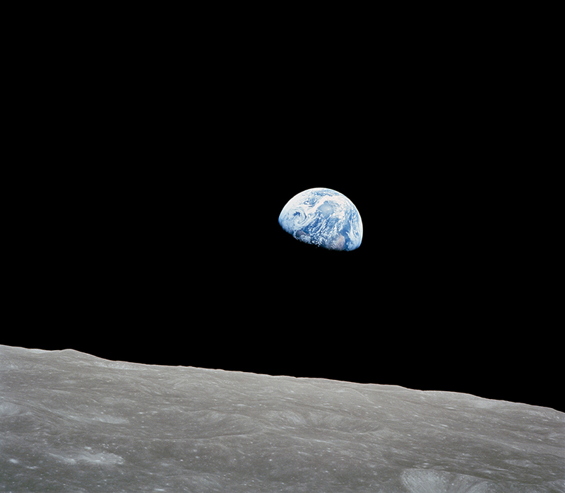 The first photo of Earth rising over the horizon of the moon
