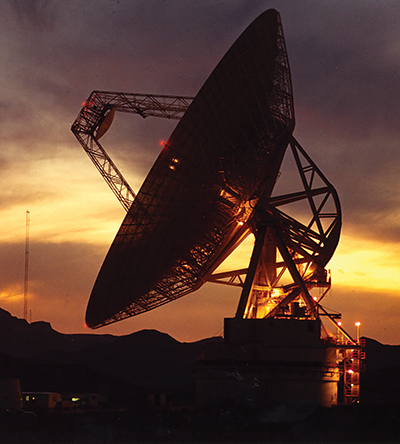 Large satellite dish at sunset