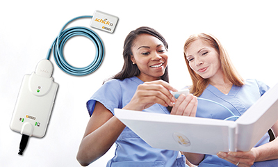 Medical professionals holding a Medical professionals holding a Schick dental imager