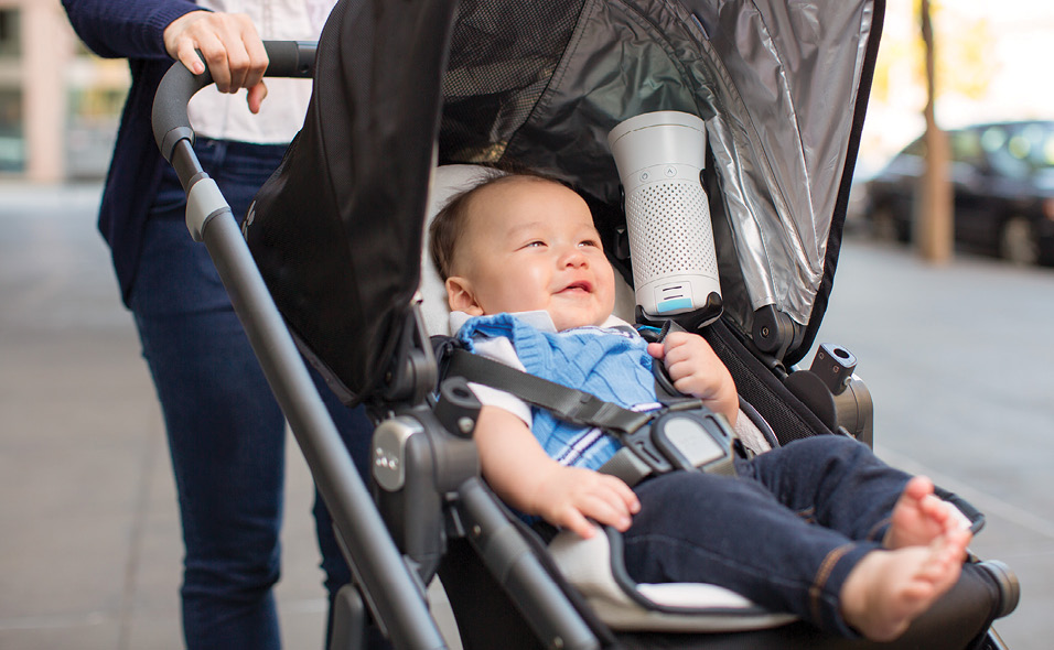 A Wynd air purifier in a stroller with a baby
