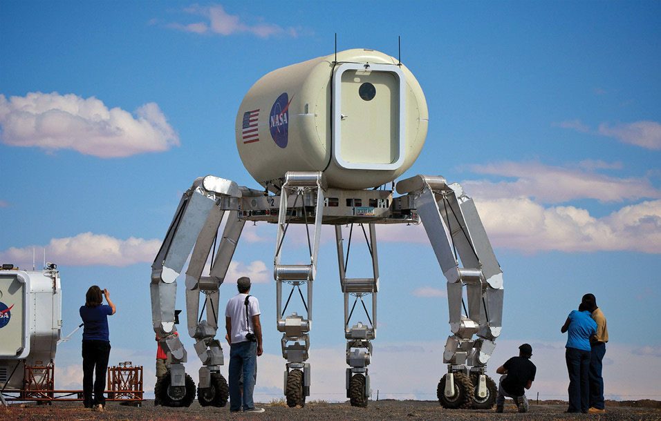 Observers take pictures of NASA's ATHLETE freight-carrying robot