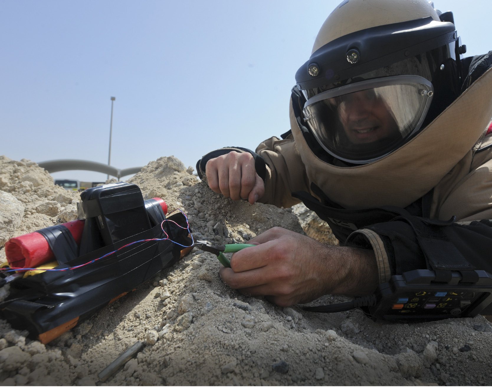 An explosive ordnance disposal worker diffuses a bomb