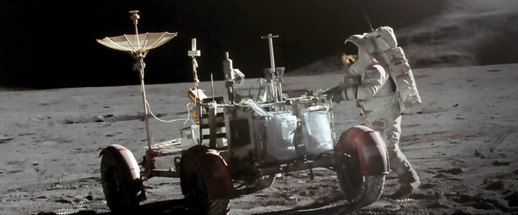 Astronaut James B. Irwin stands near the lunar roving vehicle on the Moon
