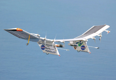 The Pathfinder Plus solar-powered, unmanned aircraft flies over the ocean