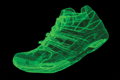 A green, semi-translucent computer rendering of a sneaker