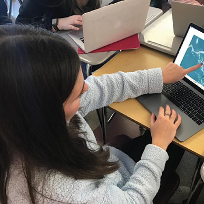 A ninth grader scours satellite imagery