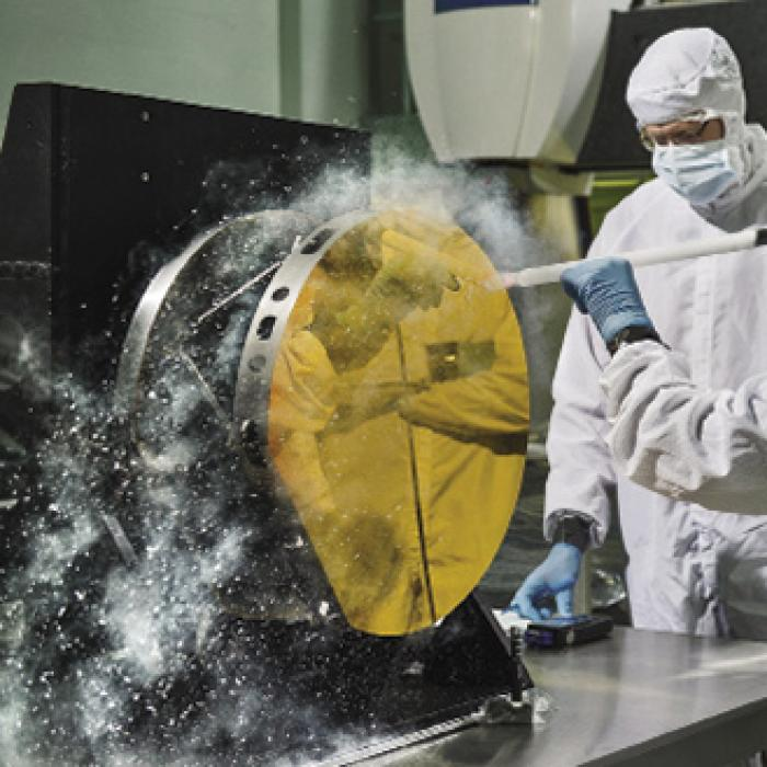 Engineers cleaning test mirror