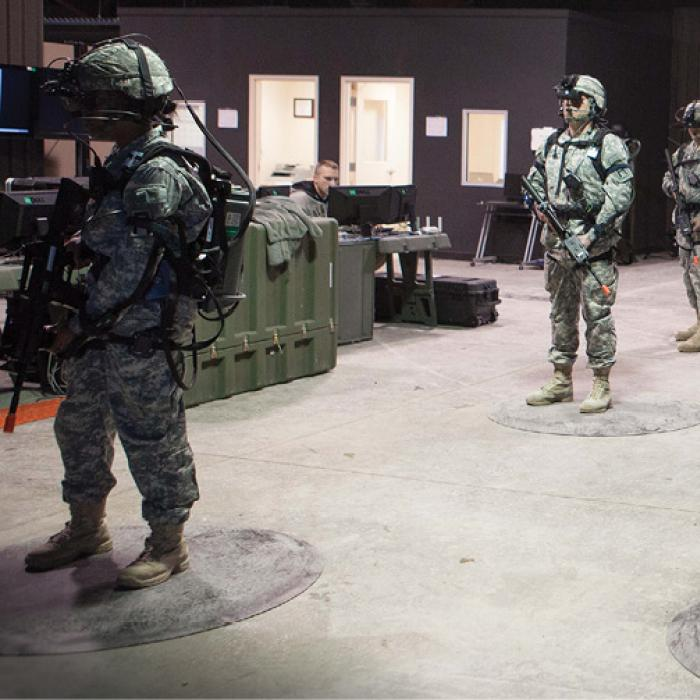 Troops wearing virtual reality gear prepare for training
