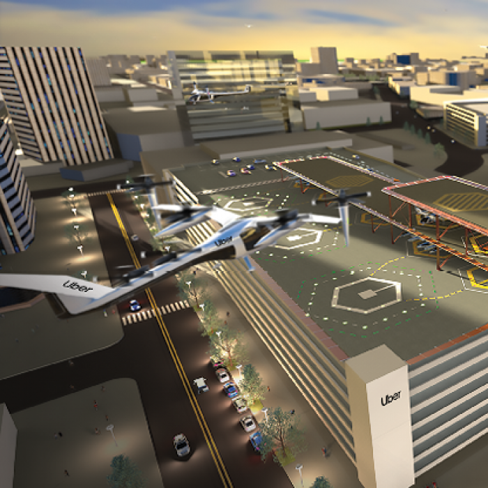 Rendering of urban air taxi rooftop landing zone, with several air taxis in flight