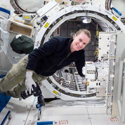 Astronaut Kate Rubins in front of the Japanese Experiment Module Airlock